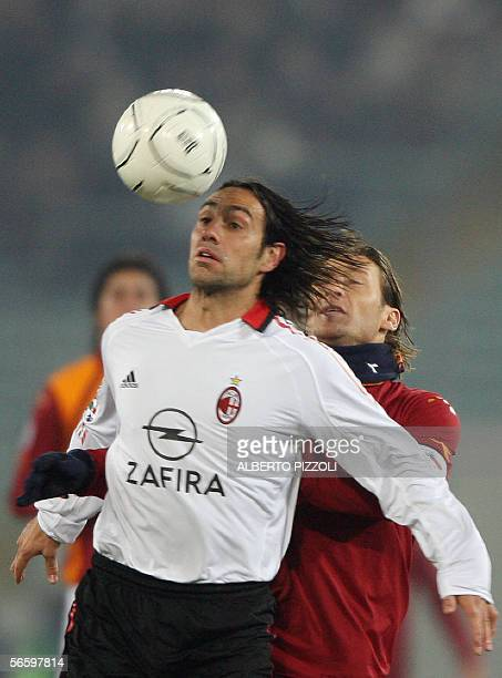 AC Milan's defender Alessandro Nesta jumps for the ball with midfielder Francesco Totti of AS Roma during their Italian Serie A football match at...