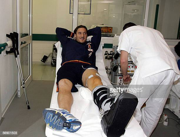 AS Roma's captain Francesco Totti is checked in a room of Rome's Villa Stuart clinic soon after surgery to his left ankle in Rome 21 February 2006...