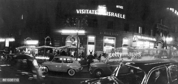 Rome Italy August 1 1958 Via Veneto the road of the 'Dolce Vita' it's night but the sotores are open the bars are crowded and traffic is chaotic