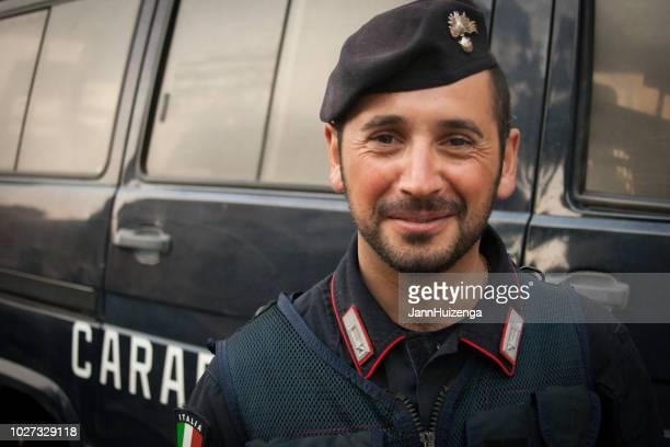Rome, Italy: Carabinieri Officer in Berets Standing with Van