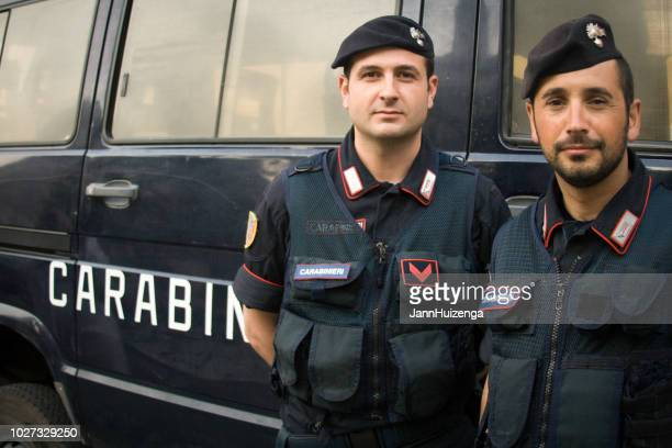 rome, italy: carabinieri officers in berets standing with van - italian military stock pictures, royalty-free photos & images