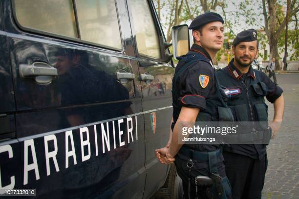Rome, Italy: Carabinieri Officers in Berets Standing with Van