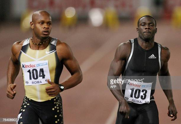 CORRECTING SPELLING TO POWELL Jamaica Asafa Powell crosses the finish line to win ahead of Bahamas Derrick Atkins placed 2nd in the men's 100m during...