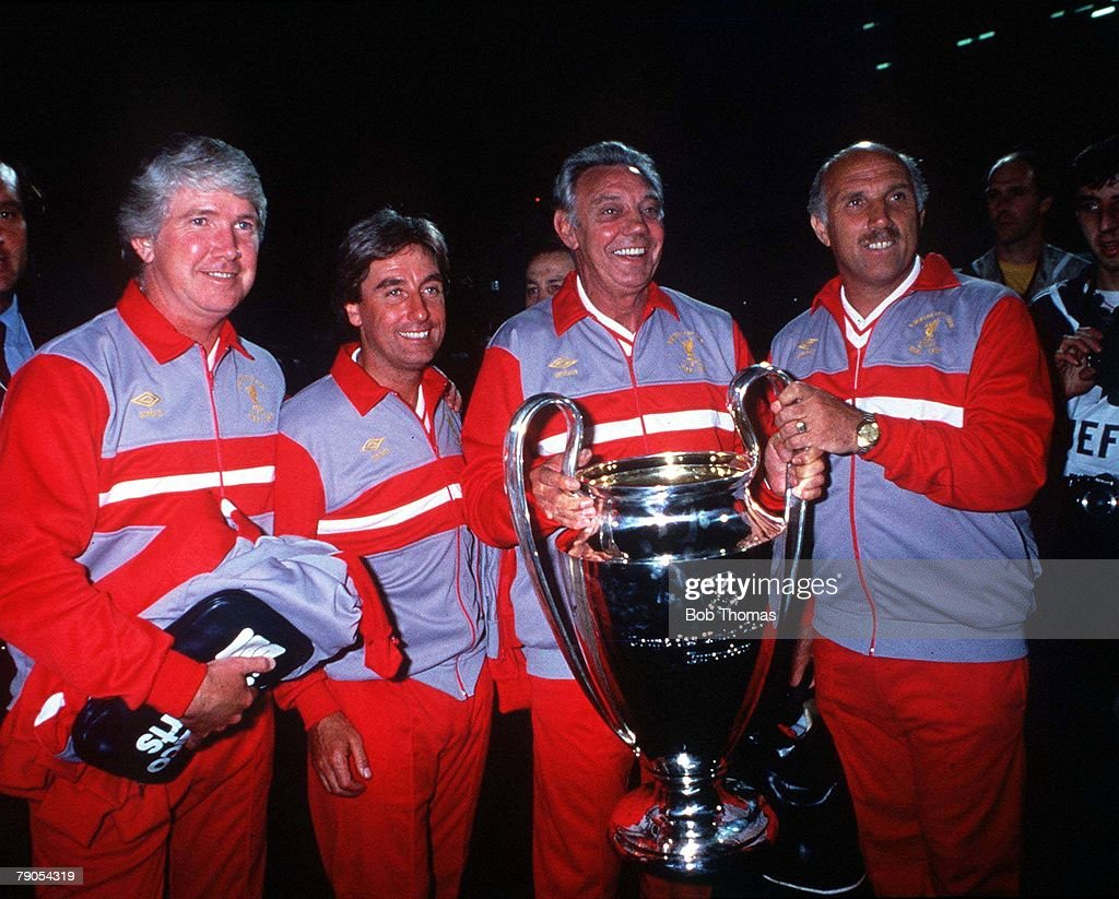 1984. Rome, Italy. European Cup Final. Liverpool (1) v AS Roma (1) (Liverpool win on penalties). Liverpool management team celebrate victory at the end. (L-R): Chris Lawler, Roy Evans, Manager Joe Fagan and Ronnie Moran. : News Photo