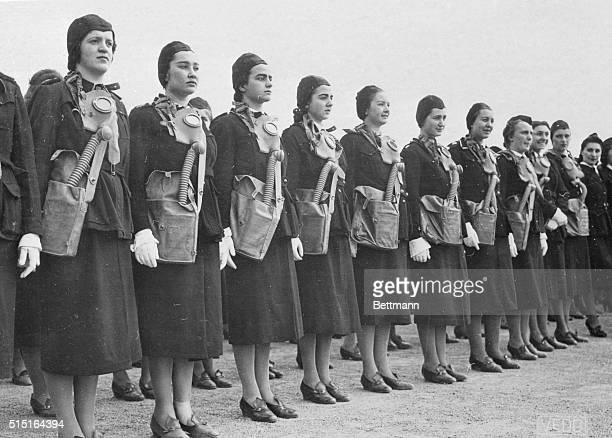 Fascist Women Parade For Il Duce Fascist women equipped with gas masks are pictured as they took part in the parade of 70000 women and girls of...