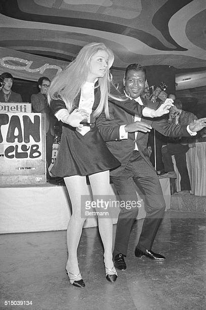 Rome Italy Former middleweight and welterweight boxing champ Sugar Ray Robinson does a dance routine with teenage Swedish Actress Ewa Aulin here Miss...