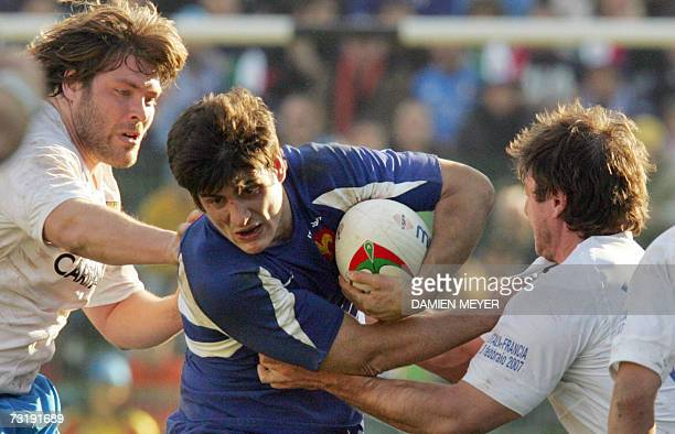 France's flyhalf David Skrela is tackled by Italy's flyhalf Ramiro Pez and Italy's prop Carlos Nieto during the Six Nations rugby union match...