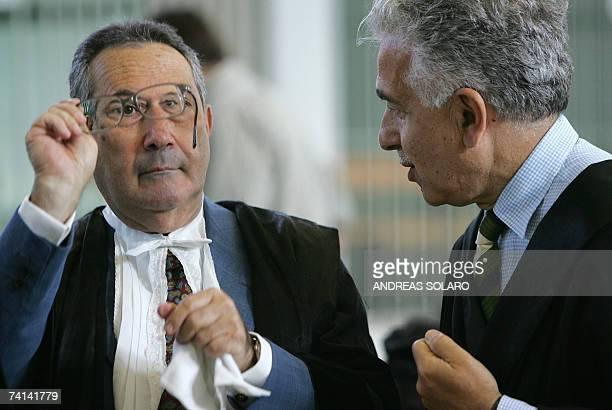 Italian journalist Giuliana Sgrena's lawyer Alessandro Gamberini and Italian secret service agent Nicola Calipari's widow Rosa lawyer, Franco Coppi,...