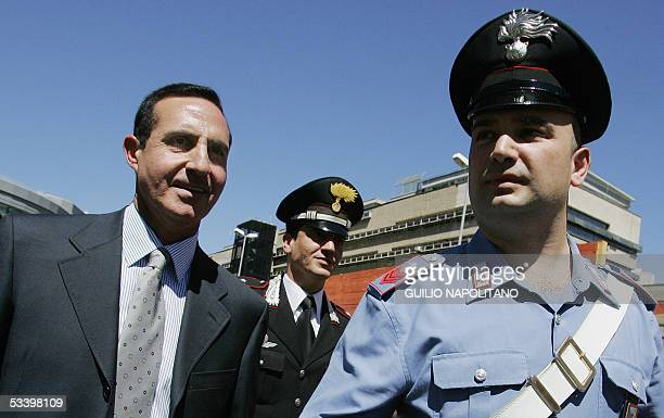 Italian Judge Domenico Miceli is escorted by Carabinieri as he leaves court in Rome 17 August 2005 after a hearing with suspected London bombing...