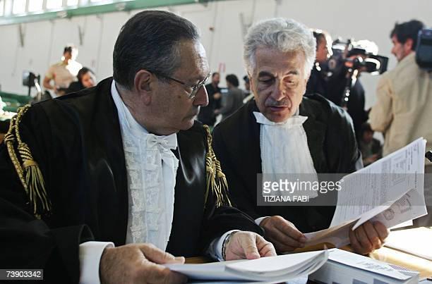 Italian secret service agent Nicola Calipari's lawyer, Franco Coppi , and Italian journalist Giuliana Sgrena's lawyer Alessandro Gamberini attend the...