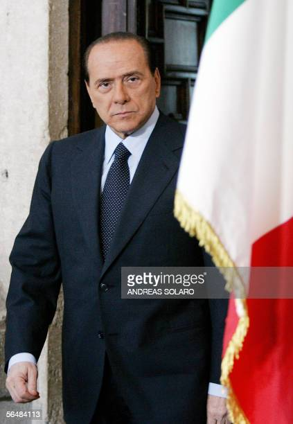 Italy's Prime Minister Silvio Berlusconi arrives for his endofyear news conference in Rome 23 December 2005 Berlusconi blamed his political foes for...