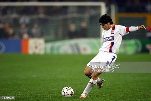 Juninho of Lyon shots a free kick during a Champions League last 16 first leg match against AS Roma at Rome's Olympic stadium 21 February 2007 The...