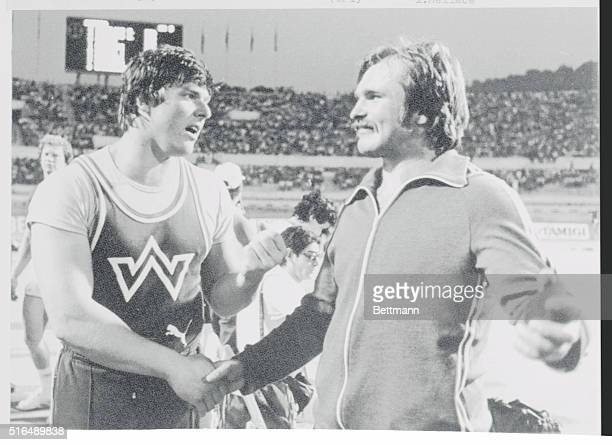 Rome, Italy: Karl Hans Riehm of West Germany who won first place in the hammer throw at the Golden Gala track and field event in Rome consoles Yuri...