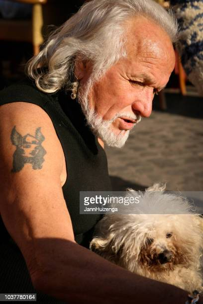 rome, italy: man with white hair and beard; white dog - hairy old man stock pictures, royalty-free photos & images