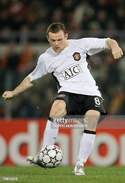 Manchester United's forward Wayne Rooney shoots to score against AS Roma during their Champion's league quarter final first leg football match at...