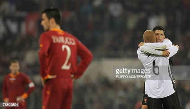 Manchester United's midfielder Cristiano Ronaldo jubilates with teammate defender Wes Brown after his side scored against Roma during their...