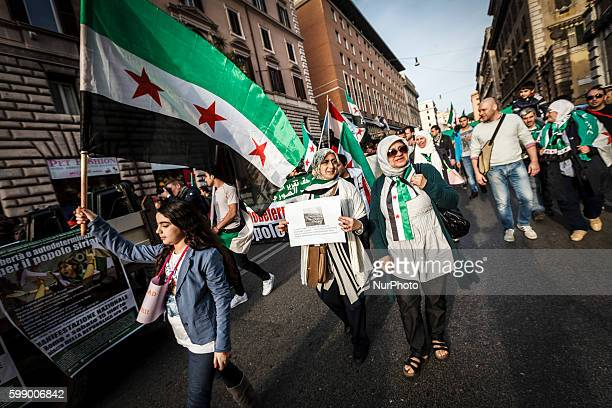 Rome Italy â' March 15 2014 Syrian demonstrators hold banners and wave flags during a rally in Rome to mark the third anniversary of Syrian...