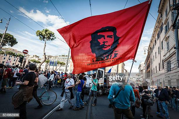 Protester waves a flag with Che Guevara face as he demonstrate during a nationwide demonstration against the privatization of the commons and the...