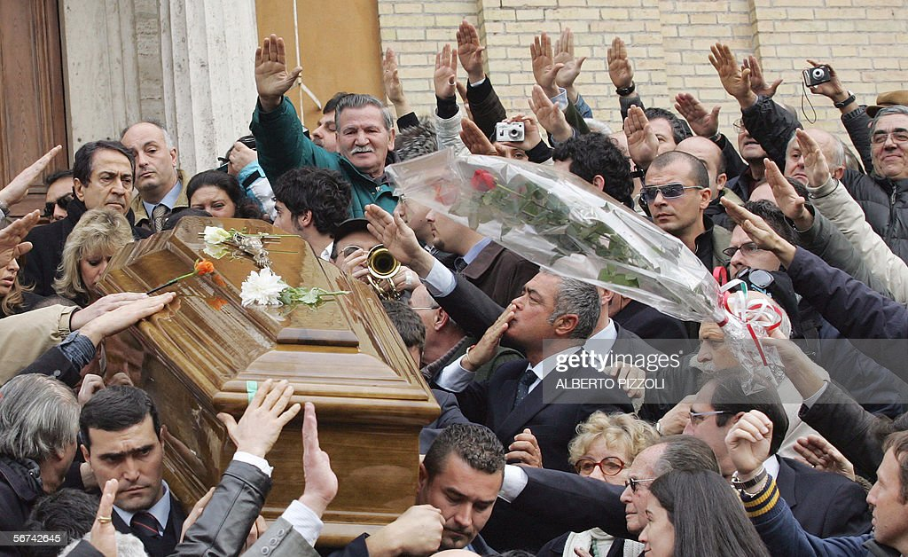 People greet with fascist salutes the co pictures getty images people greet with fascist salutes the coffin of romano mussolini outside the church dei santi angeli m4hsunfo