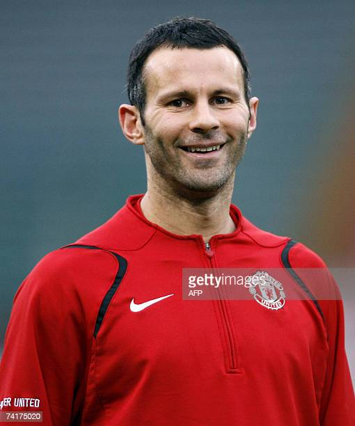 Picture taken 03 April 2007 shows Manchester United's midfielder Ryan Giggs smiling during a training session at the Olympic Stadium in Rome Italy on...