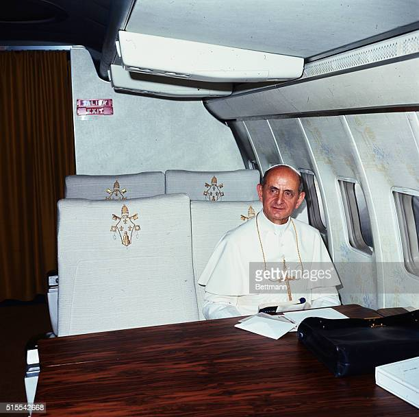 Pope Paul VI is shown seated inside the Avianca Airlines plane that will fly him to Bogota Colombia where he will attend the International...