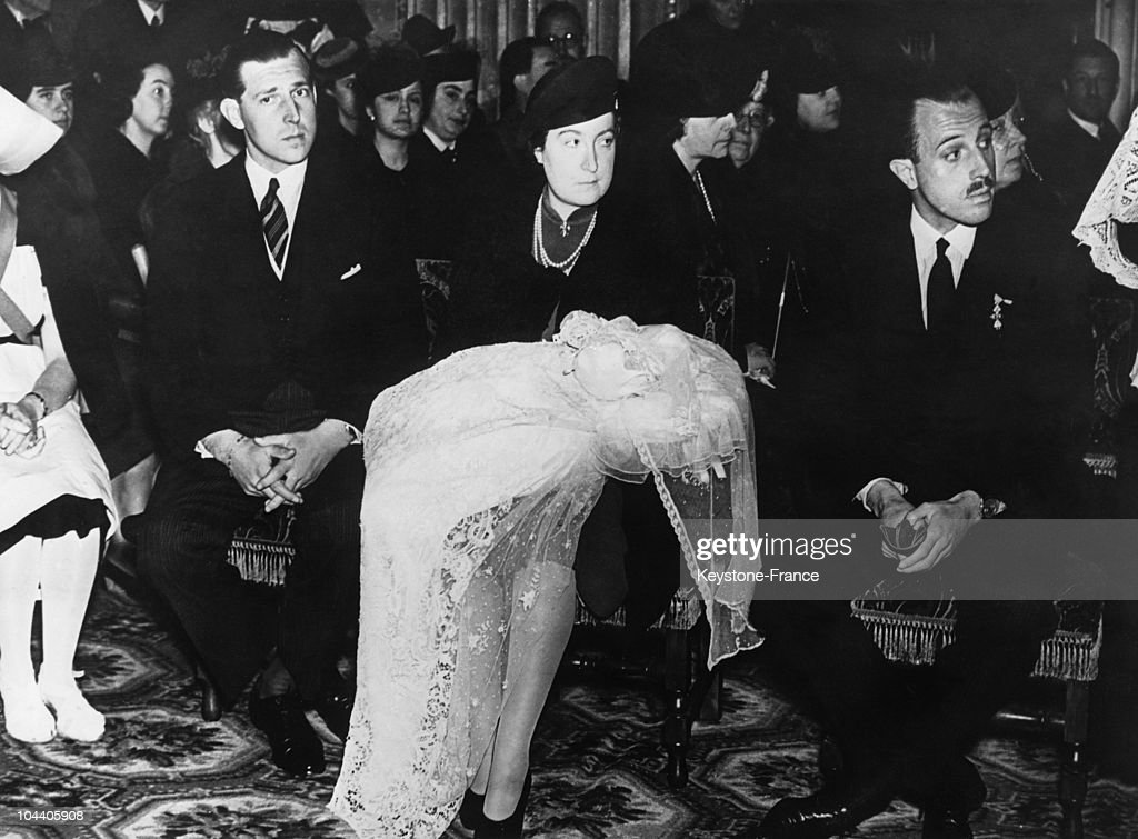 Rome, Italy. Prince JUAN, count of Barcelona and Princess MARIA de las MERCEDES holding her baby on her knees are christening their elder son JUAN CARLOS I. The ceremony took place in the Spanish Church, Via Monserrato (Rome) in the presence of former sovereigns of Spain.