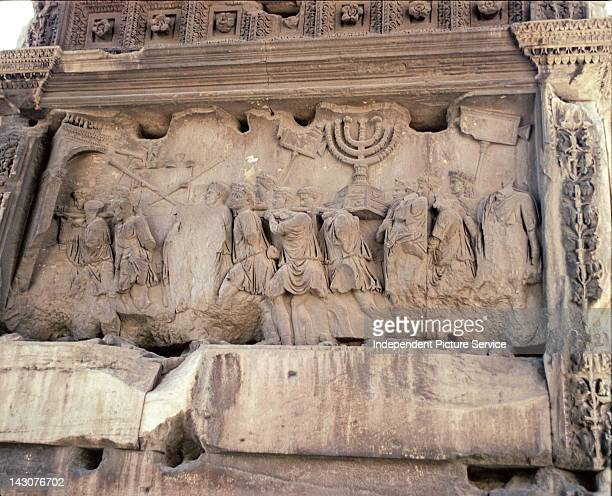 Rome Italy Relief sculpture on the Arch of Titus depicting the sacking of Jerusalem in the year 70 AD by the Romans during the First JewishRoman War