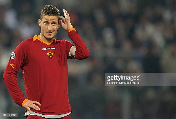 Roma's forward Francesco Totti scratches his head after missing a penalty during Italian Coppa Italia semifinal return football match against AC...