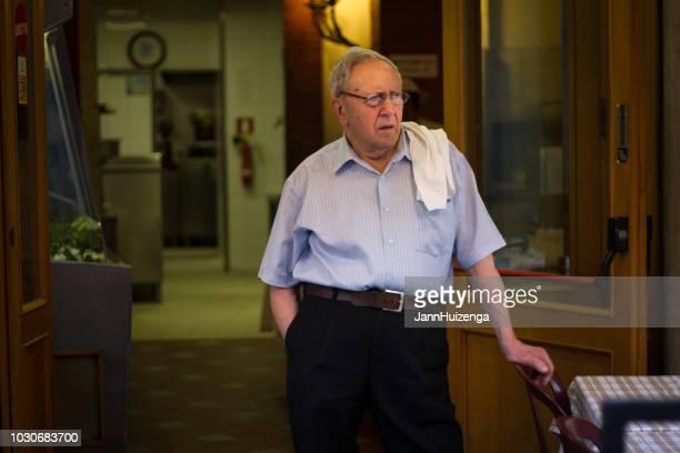 Rome, Italy: Senior Waiter in Restaurant Doorway