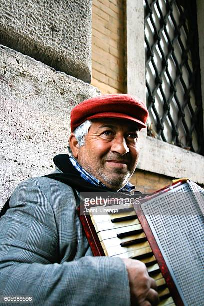 Rome, Italy: Street Musician in Red Cap with Accordion (Close-Up)