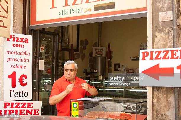 Rome, Italy: Take-Away Pizzeria Kiosk and Clerk (Close-Up)