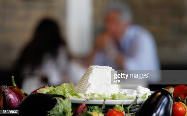 TO GO WITH AFP STORY 'La revolution ecogastronomique du 'slow food' A ricotta cheese is seen inside 'slow food' restaurant Gusto in central Rome 11...