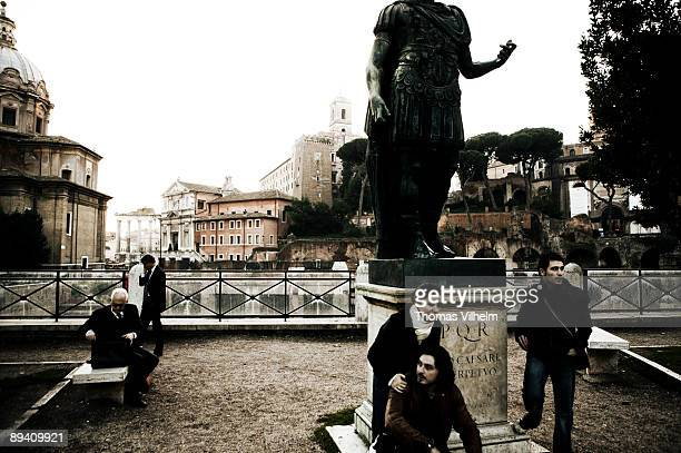 Rome Italy Tourists at the Roman Forum The Roman Forum was the central area around which ancient Rome developed in which commerce and the...