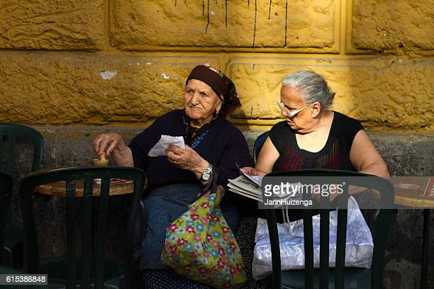 Rome, Italy: Two Senior Women Relax at Outdoor Cafe