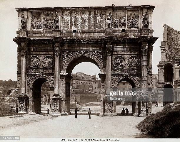 Rome Italy Undated view of the Arch of Constantine and side of the Colisseum with passersby