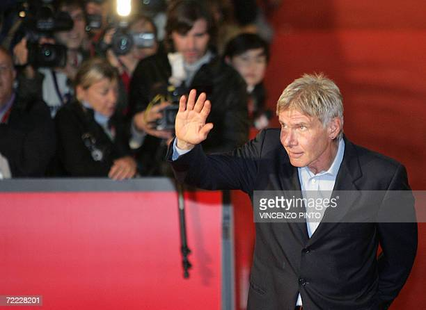 US actor Harrison Ford waves to fans as he arrive at Rome's Auditorium 20 October 2006 during the first edition of the Rome Film Festival Ford is at...