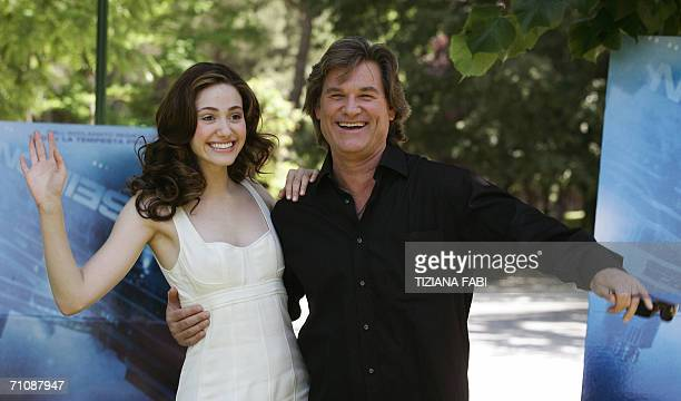"Actors Kurt Russel and Emmy Rossum joke during a photocall to present ""Poseidon"" directed by German Wolfgang Petersen, 31 May 2006 in Rome. AFP PHOTO..."