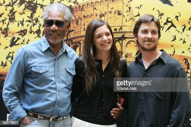US actors Morgan Freeman Katie Holmes and British actor Christian Bale pose for photographers during the presentation of their film Batman Begins in...