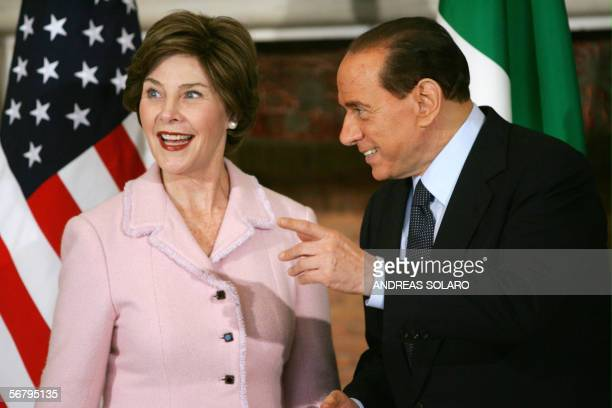 US first lady Laura Bush looks away as Italy's Prime Minister Silvio Berlusconi gestures at Villa Madama in Rome 09 February 2006 Bush is on a...