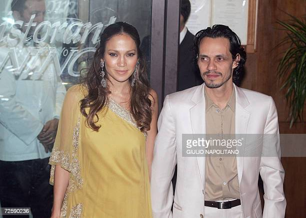 US stars Jennifer Lopez and her husband Marc Antony leave a restaurant in central Rome early 17 November 2006 after having dinner with US actors Tom...