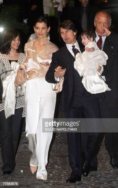 US superstars Tom Cruise and his fiancee Katie Holmes holding their daughter Suri arrive at a restaurant in central Rome 16 November 2006 They are...