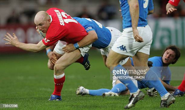 Wales' center James Hook is tackled by Italy's flyhalf Ramiro Pez during the Six Nations rugby union match Italy vs Wales at Flaminio stadium in Rome...