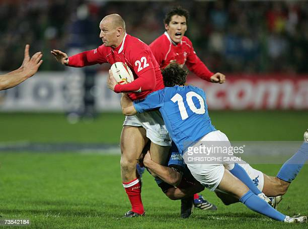 Wales' centre Gareth Thomas is tackled by Italy's flyhalf Ramiro Pez during the Six Nations rugby union match Italy vs Wales at Flaminio stadium in...