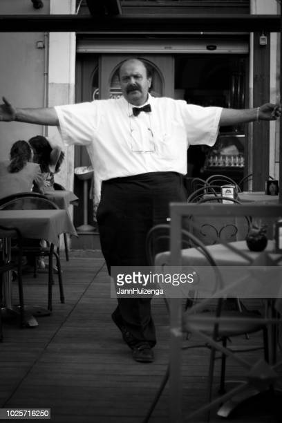 Rome, Italy: Welcoming Waiter with Arms Outstretched