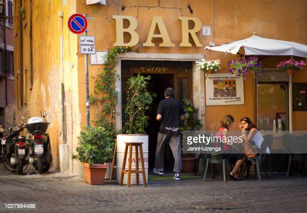 Rome, Italy: Women Chat At Outdoor Coffee Bar, Trastevere