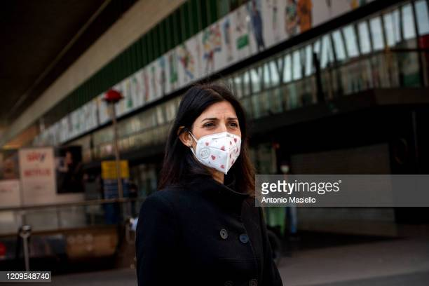 Rome Mayor Virginia Raggi visits the Termini train station as Italian Red Cross staff begin to carry out body temperature checks with a thermoscanner...