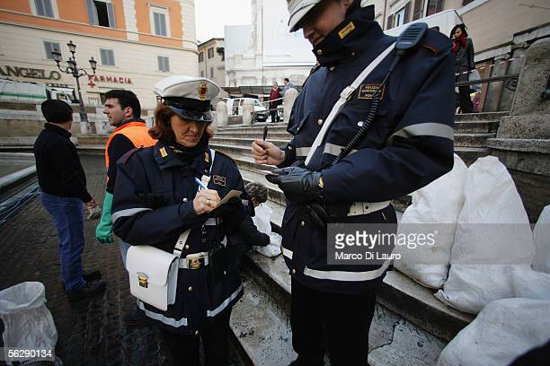 Rome Municipality Police account for coins at the Trevi Fountain November 28 2005 in Rome Italy Tourists from all over the world come to Rome's Trevi...