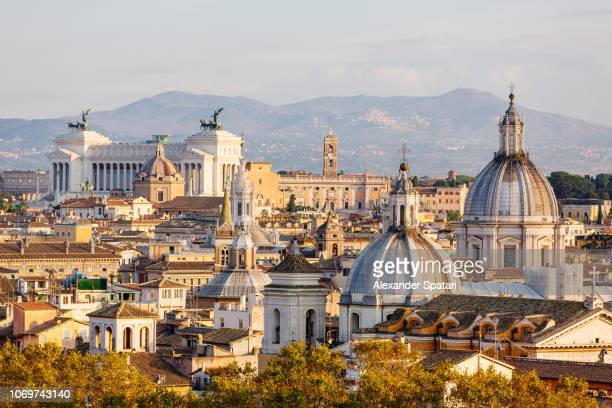 rome skyline at sunset, lazio, rome - rom italien stock-fotos und bilder