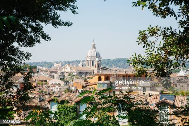 rome skyline seen through the trees, lazio, italy - rome italië stockfoto's en -beelden