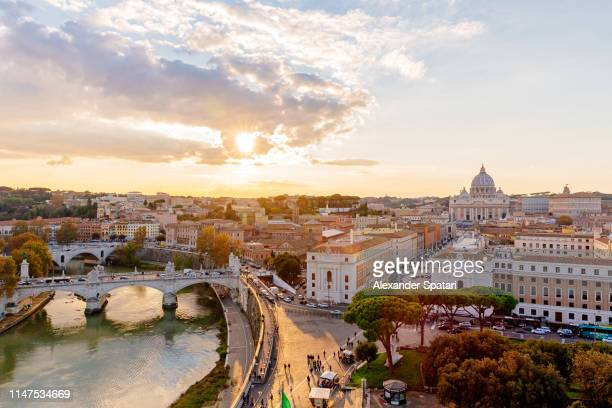 rome skyline with tiber river and vatican at sunset, italy - rome italy stock pictures, royalty-free photos & images
